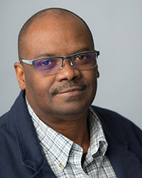 "Audio Interview with Handel Wright on BC BUZZ show ""In the Spotlight"" discussing Canadian and American multiculturalism"